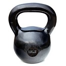 black shiny 35 lb iron kettlebell for weightlifting and fitness training isolated on white