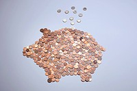 Euro coins falling into a piggy bank made from arranged European coins (thumbnail)