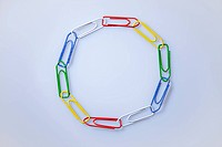 Multi colored paperclips arranged in a circle