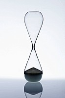 Sand at the bottom of an hourglass