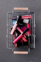 Cosmetics in shopping basket