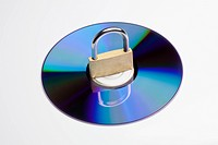 A compact disc with a padlock on top of it
