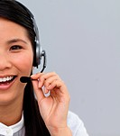 Close_up of a laughing customer service agent using headset