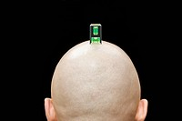 A camera spirit level on the head of a man, rear view