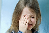Close_up of a young girl crying