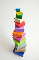 A stack of multi colored gift boxes