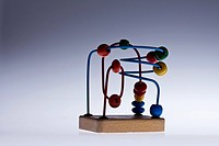 A wooden bead maze children's educational toy