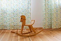 A rocking horse in a domestic room