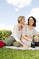 Women having picnic together outdoors