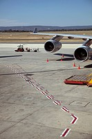 Luggage trolley moving away from jet (thumbnail)