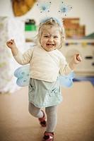 Smiling girl wearing fairy costume