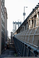 Outer barrier of Manhattan Bridge with road below