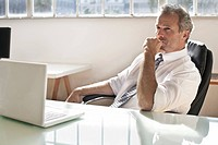 Businessman thinking at desk