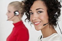 Businesswomen wearing headsets