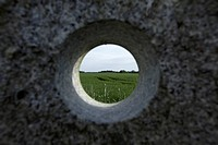 A remote natural landscape seen through a hole in granite