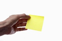A man holding a blank yellow adhesive note, close_up of hand