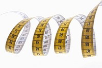 A centimeter tape measure arranged in a spiral shape (thumbnail)