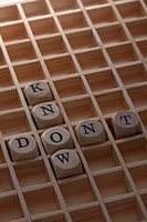 A grid with lettered cubes spelling the words Don't Know