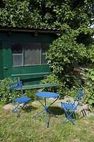 Outdoor furniture in the garden of a summer cottage