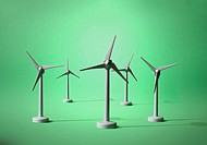 Five models of wind turbines on a green background