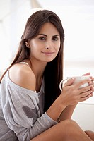 Comfortable woman holding coffee cup