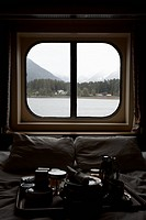 View of Juneau, Alaska thru bedroom window of a passenger ship