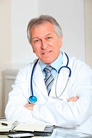 Closeup of doctor in the office with arms crossed