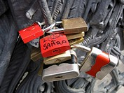 Lovelocks of passion on a bridge, attached by couples as a symbol their devotion