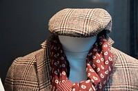 Headless mannequin with checked clothing, polo neck and scarf