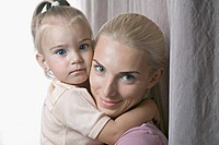 A beautiful young girl and her mother, close_up