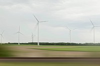 Wind turbines and landscape in blurred motion viewed from moving train (thumbnail)