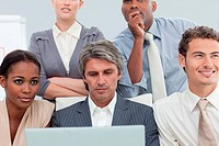 Serious Multi_ethnic business people using a laptop