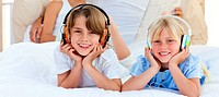 Close_up of siblings listening music