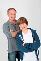 Father and son standing on white background