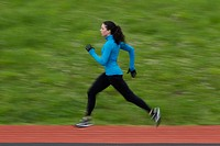 Woman sprinting around track