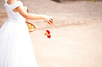 Girl holding rose petals at the wedding