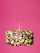 Cake with candy and one light