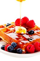Syrup Pouring Over Waffles