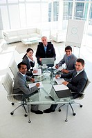 High angle of a business team smiling at the camera