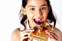 Close up shot of a girl eating chocolate