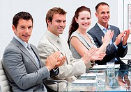 Business team applauding in a meeting