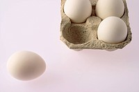 Partial view of eggs in the egg carton