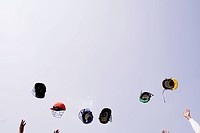 Cricket helmets flying mid_air