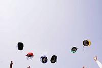 Cricket helmets flying mid_air