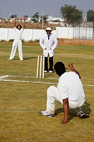 Bowler and fielder appealing to the umpire