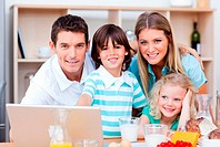 Loving family using laptop during the breakfast