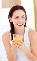 Laughing woman drinking orange juice