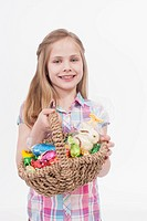 Girl with easter egg basket, smiling, portrait