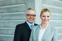 Germany, Stuttgart, Business people in office lobby, smiling, portrait