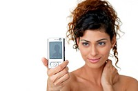Young woman clicking her own picture using mobile phone